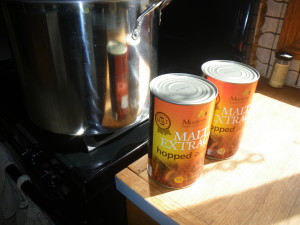 Cans of Malt Extract Waiting for the Boil